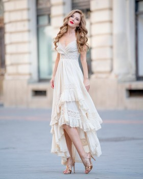 High-low flared beige cotton dress with laced bodice and layered ruffles